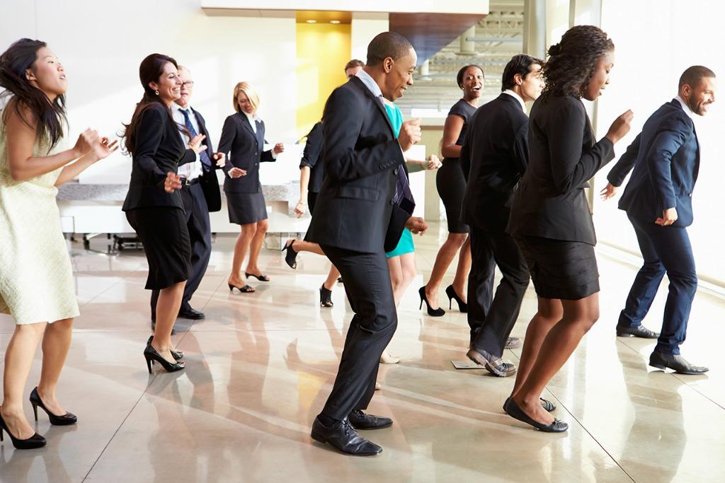 coworkers dancing at work
