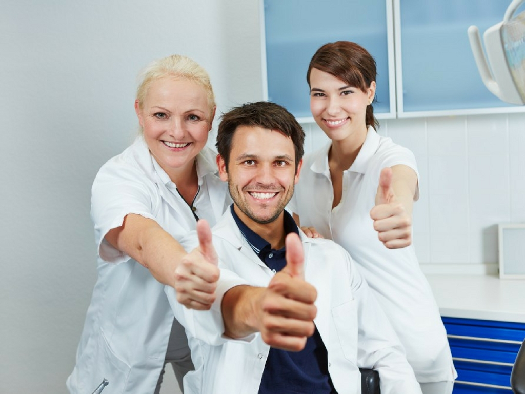dental team giving thumbs up
