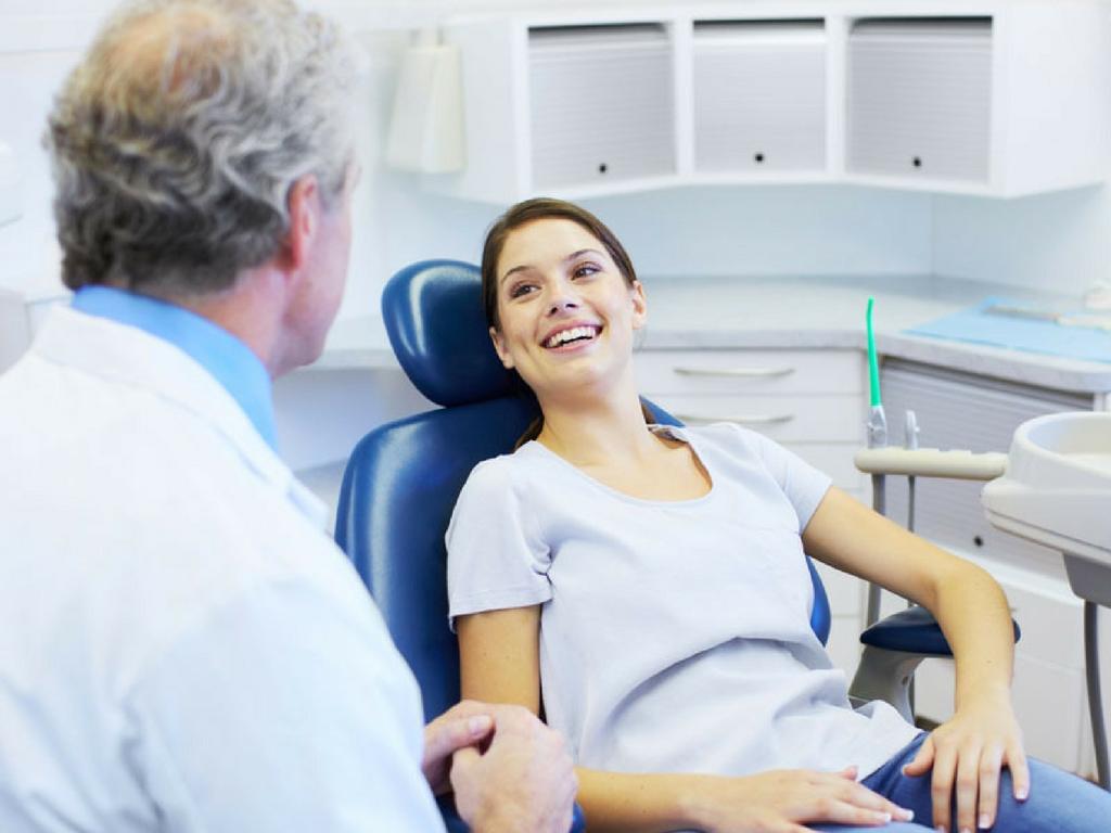 happy patient dentist conversation