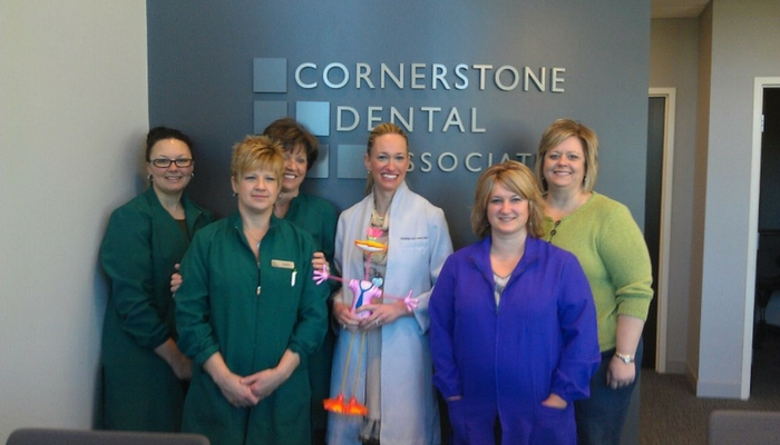 amy scoggins with her team at cornerstone dental associates