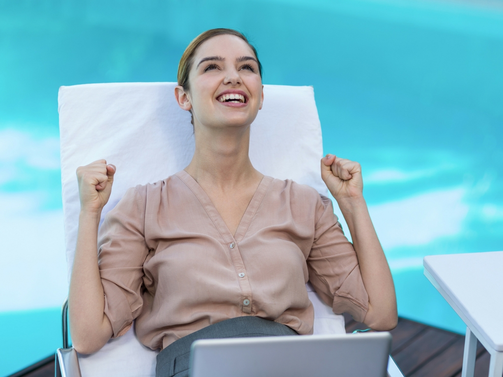 excited girl with laptop by pool