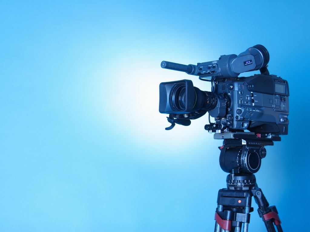 video camera with blue background