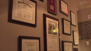 Dr. Shelley Shults' wall of certificates and degrees