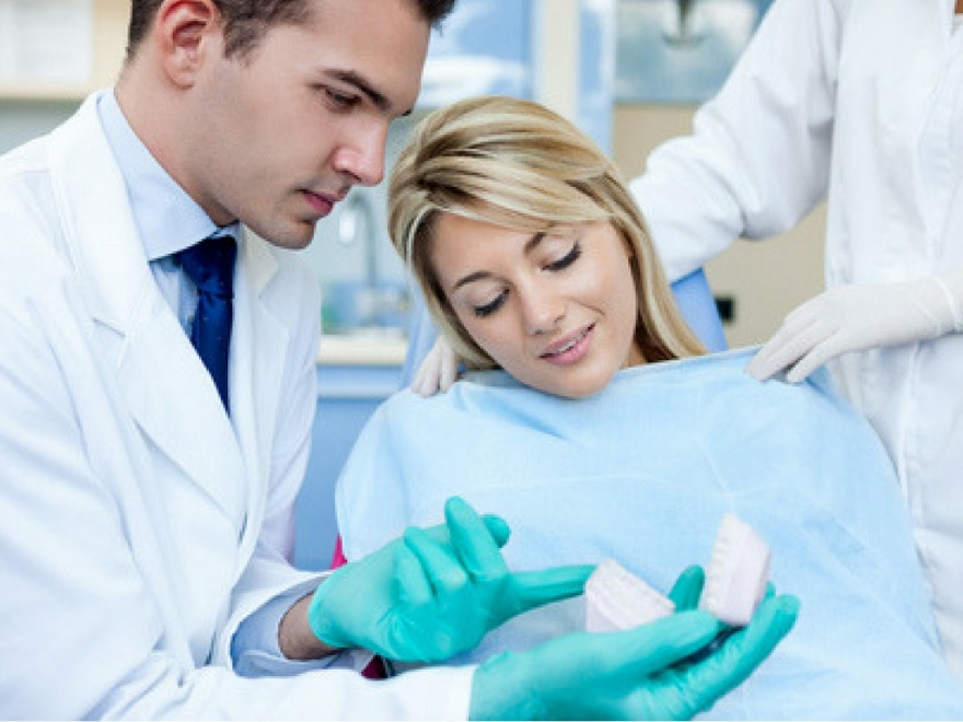 dentist discussing treatment options with patient