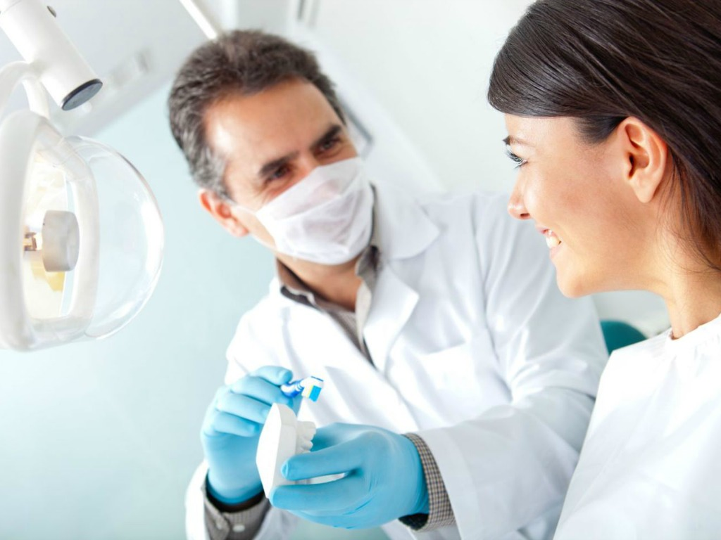oral hygienist educating patient