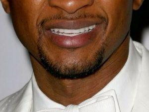 usher smile closeup