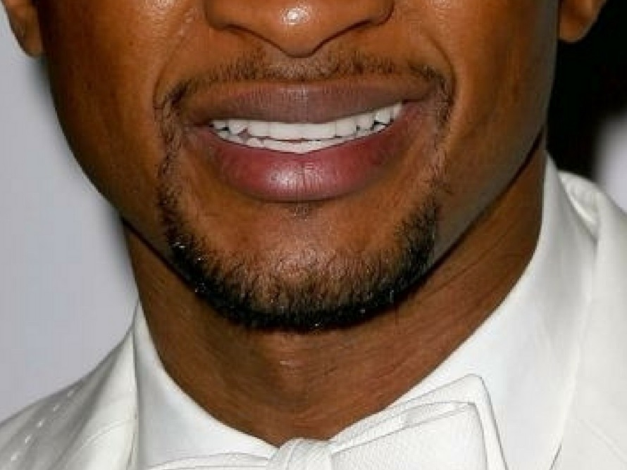 usher smile closeup