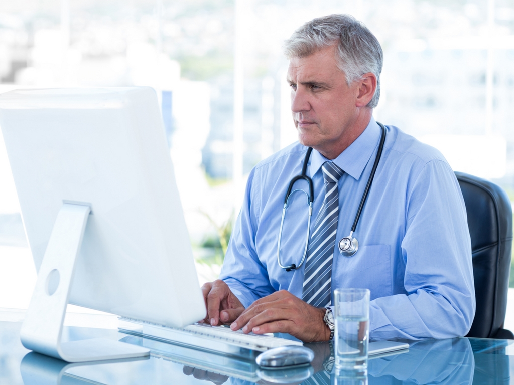 male medical professional at computer