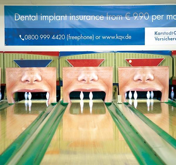 creative dental advertising at bowling alley