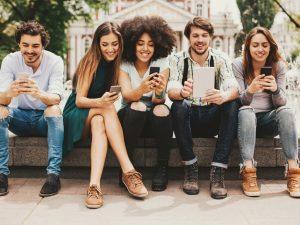 people sitting on their phones