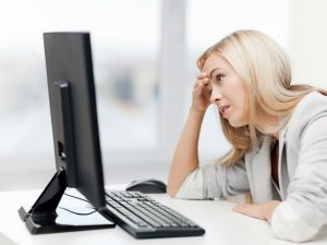 stressed girl looking at computer