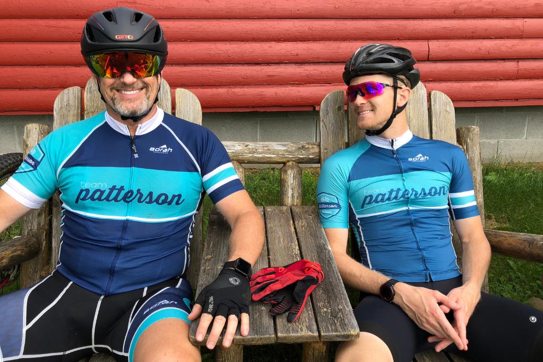 patterson wiz guys wearing matching father and son biking uniforms